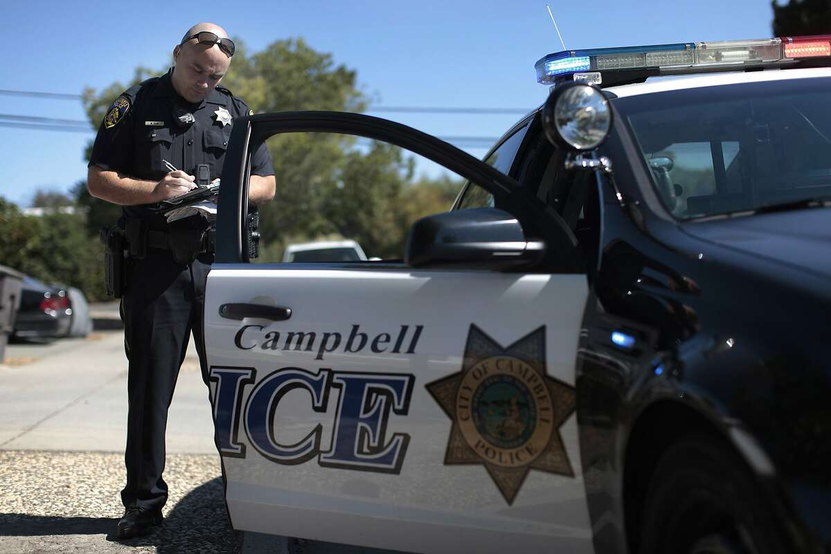 Officer Matt Ryan writes up a ticket on Friday, Aug. 22, 2014 in Campbell, Calif. The Campbell Police Department says that the cameras have actually helped to exonerate police officers over the years rather than harm them.