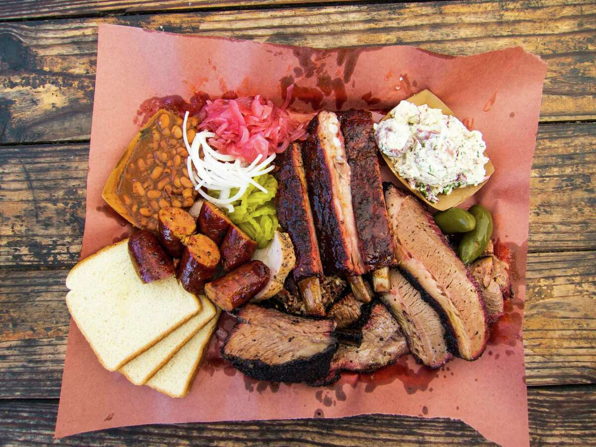 A spread of barbecue made by John Lewis, pictured below, at la Barbecue in Austin.