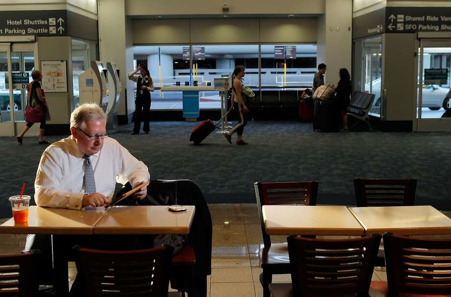Motive Television CEO Leonard Fertig demonstrates his company's Tablet TV at San Francisco International Airport. Photo: Carlos Avila Gonzalez, The Chronicle