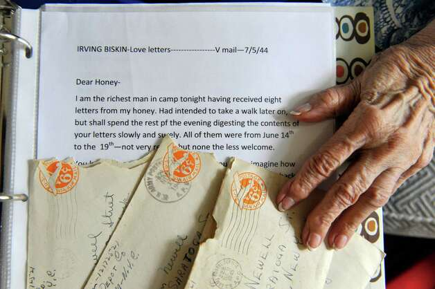 Miriam Biskin holds some of  the letters her late husband, Irving, sent her from Europe during World War II, along with a typed page of one of the letters, on Wednesday, Aug. 20, 2014, in Bethlehem, N.Y.  Biskin is typing the letters to put a book together.  (Paul Buckowski / Times Union) Photo: Paul Buckowski / 00028256A