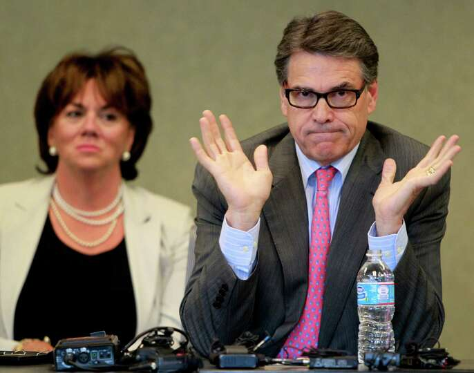 Texas Gov. Rick Perry speaks to a group of business leaders, Friday Aug. 22, 2014 in Portsmouth, N.H
