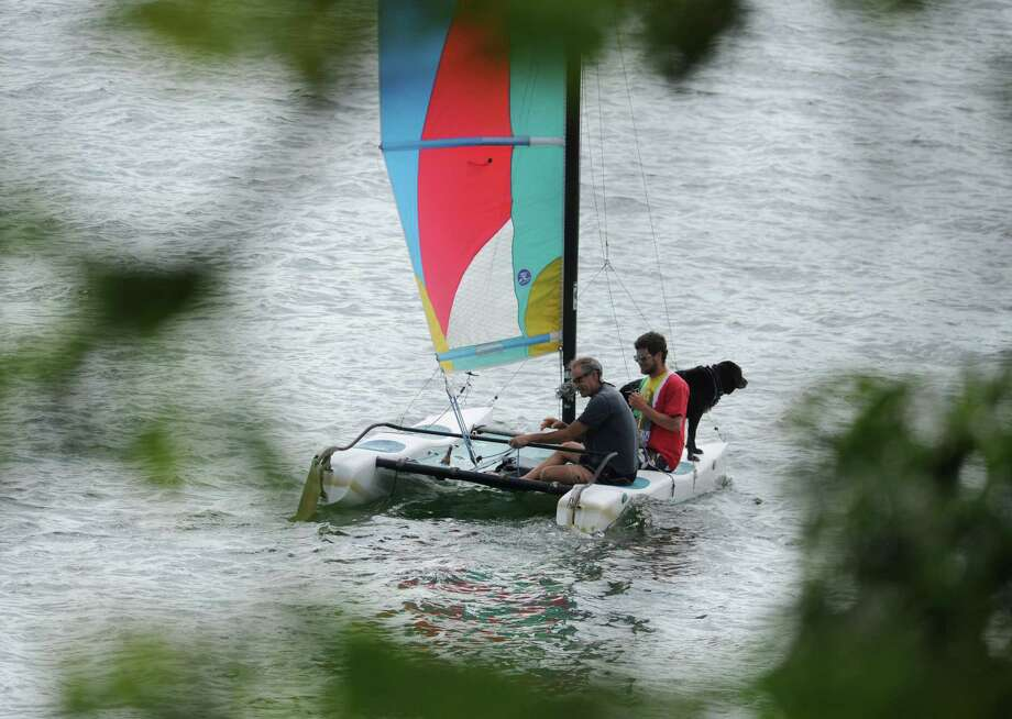 Boaters and their dog cruise in a sailboat on Candlewood Lake in Brookfield, Conn. Thursday, Aug. 7, 2014. Photo: Tyler Sizemore / The News-Times