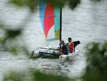 Boaters and their dog cruise in a sailboat on Candlewood Lake in Brookfield, Conn. Thursday, Aug. 7, 2014.