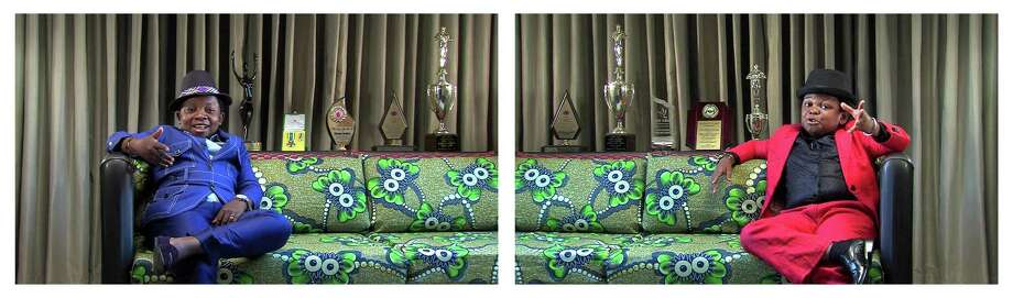 """A still from Candice Breitz's """"The Interview,"""" part of the trilogy """"The Woods,"""" on view at Blaffer Art Museum through Sept. 6.  (The Interview, 2012  Shot at Wheatbaker Hotel, Lagos, Nigeria, June 2012  Dual-channel video installation  76:07 minutes (continuous loop)  Commissioned by Peabody Essex Museum and Australian Centre for the Moving Image) Photo: Candice Breitz / ONLINE_YES"""