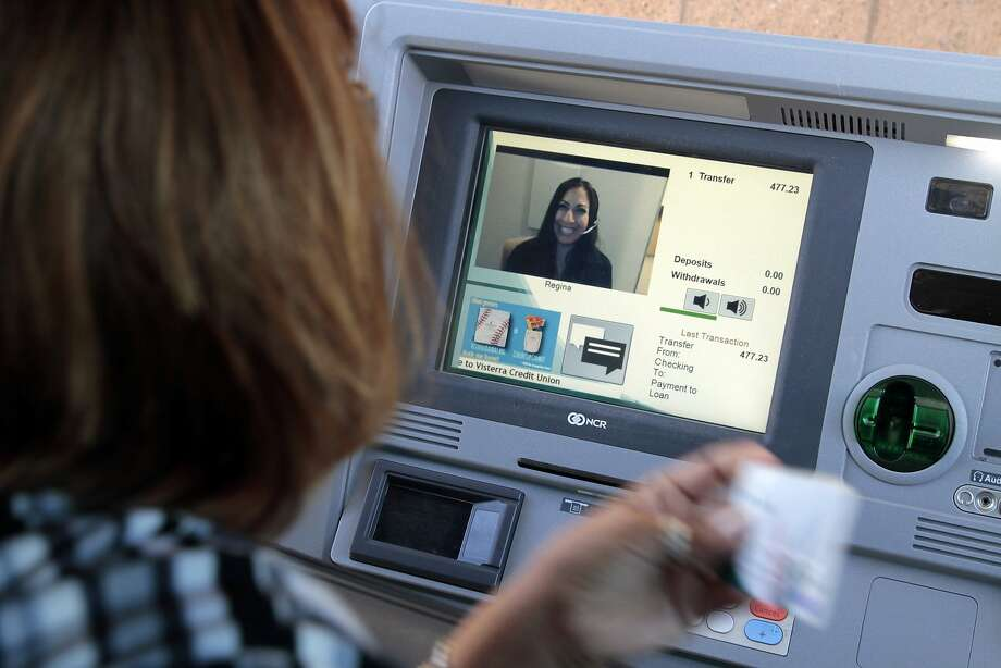 Veronica Vallejos talks to Regina as she makes a loan payment while using the drive-thru at Visterra Credit Union. Photo: Glenn Koenig, McClatchy-Tribune News Service