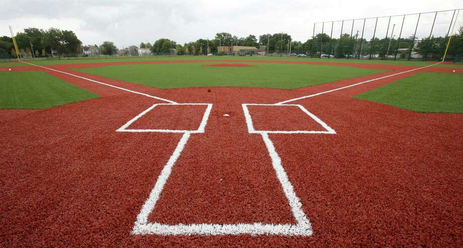 This Thursday, Aug. 21, 2014 photo shows the restored field at League Park in Cleveland. The city of Cleveland has invested $6.3 million in restoring the old site of League Park, a historic site where the Cleveland Indians clinched its 1920 World Series title, Babe Ruth hit his 500th home run and where Joe DiMaggio extended his hitting streak to 56 games. Not much of the old ballbark, where Cy Young threw the first pitch in 1891 remains, but the new park will host high school and youth games on its all-turf field and will pay homage to the greats who once played there. (AP Photo/Tony Dejak) Photo: Tony Dejak, Associated Press / AP