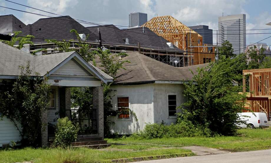 New construction is dwarfing the old homes in Houston's Third Ward. ( Gary Coronado / Houston Chronicle ) Photo: Gary Coronado, Staff / © 2014 Houston Chronicle