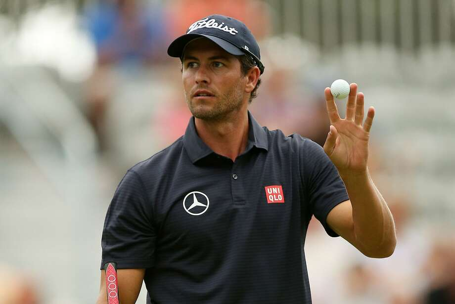 PARAMUS, NJ - AUGUST 22:  Adam Scott of Australia reacts after putting for birdie on the 18th green during the second round of The Barclays at The Ridgewood Country Club on August 22, 2014 in Paramus, New Jersey.  (Photo by Darren Carroll/Getty Images) Photo: Darren Carroll, Getty Images