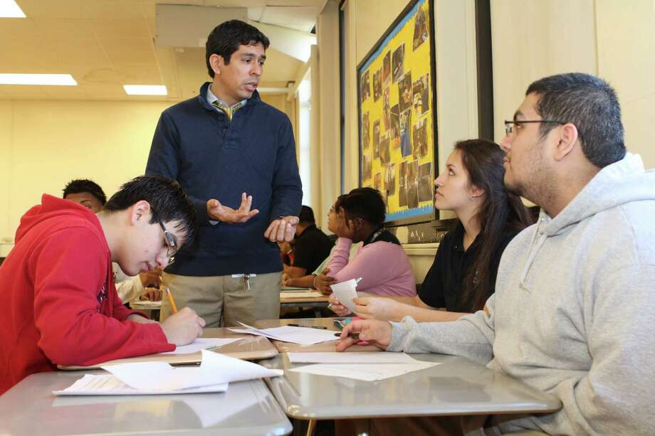 Teacher Armando Orduna talks to students from HISD's Austin High School.