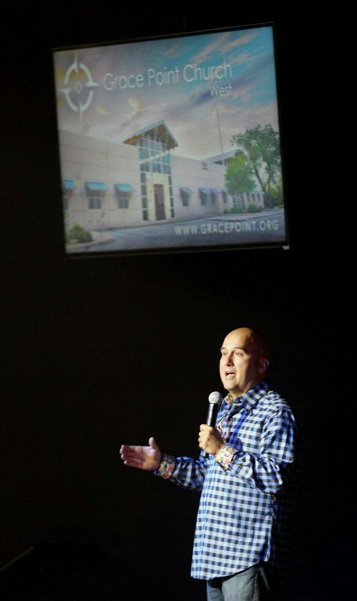 Pastor Jeff Harris of Grace Point Church West delivers his sermon Aug. 10 during one of the first services at the new establishment off of Loop 1604 and Leslie Road. The grand opening of the new church is planned today.