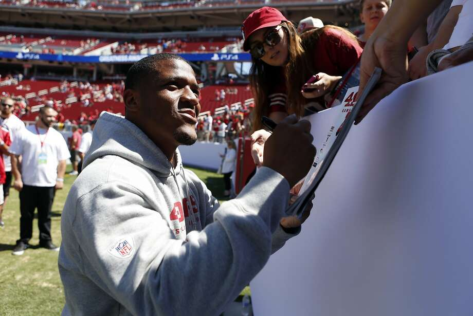 LaMichael James, signing for a fan, will return to the field sooner than expected. Photo: Scott Strazzante, The Chronicle