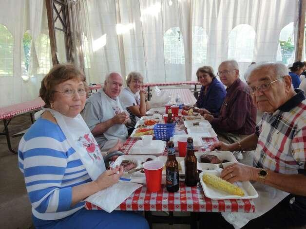 Ben Migliore, Lou Buhrmaster, Judy Buhrmaster at Schenectady Day Nursery's 14th Annual Steak & Lobster Fest. (Joanne DeVoe, Schenectady)