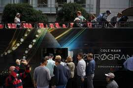 Passengers wait to board a tour bus in Union Square on Friday, Aug. 22, 2014 in San Francisco, Calif. Navigating the city as a tourist can be difficult due to the convoluted layout of streets.