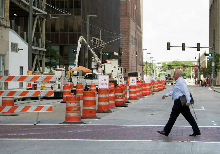 """I'm ready for it to be over,"" Max Johnson says of the construction on Capitol and elsewhere downtown. Photo: Cody Duty, Staff / © 2014 Houston Chronicle"