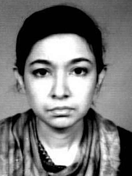 FILE - This undated file photo released by the FBI shows terror suspect Aafia Siddiqui. The U.S.-trained scientist from Pakistan who was convicted of trying to murder U.S. agents and military officers in Afghanistan should be sent to prison for 12 years rather than life because she is mentally ill, her lawyers said in court papers Wednesday Sept. 22, 2010. (AP Photo/FBI, File) Photo: Anonymous, HO / FBI