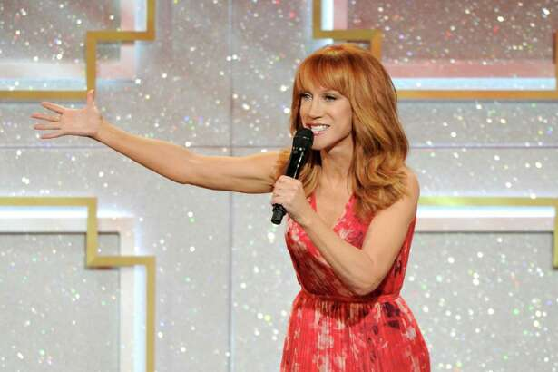 "FILE - This June 22, 2014 file photo shows host Kathy Griffin on stage at the 41st annual Daytime Emmy Awards at the Beverly Hilton Hotel in Beverly Hills, Calif. The 53-year-old comedian said after watching the eye-popping, rump-shaking music video for Nicki Minaj's new hit single, ""Anaconda,"" she wants to go toe-to-toe with the rap diva. ""Of course, everyone's talking about that 'Anaconda' video and it's fantastic. It's a lot of boo-tay and I would like to challenge Nicki to a boo-tay-off,"" Griffin said in an interview this week. (Photo by Chris Pizzello/Invision/AP, File) ORG XMIT: NYET501"