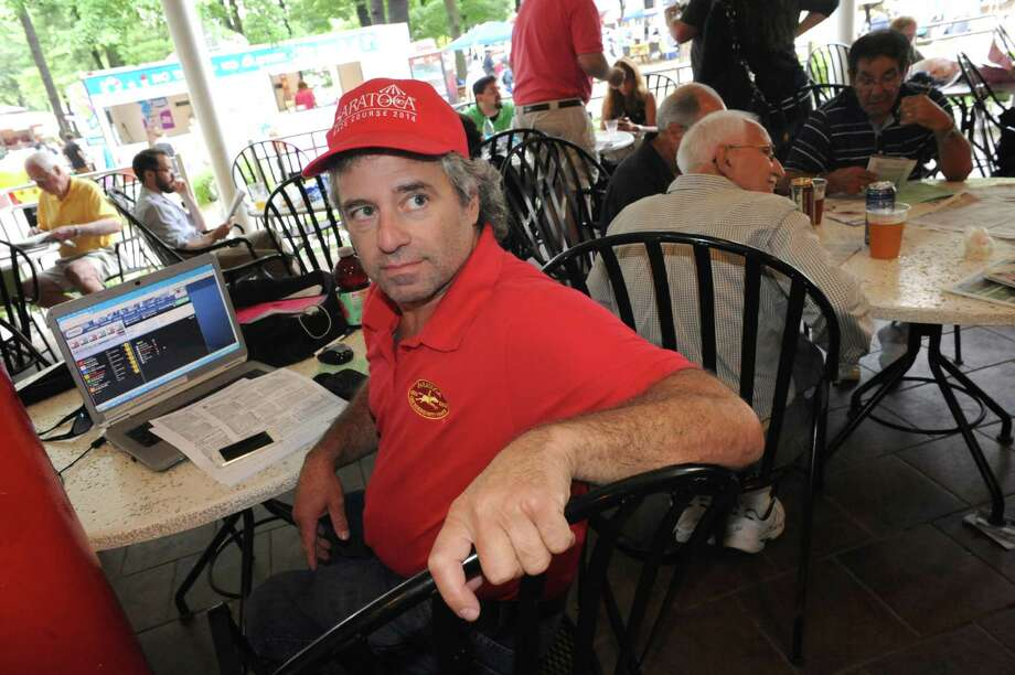Dave Gonzales of Saratoga uses the newly redesigned NYRA online betting site Thursday Aug. 21, 2014, at Saratoga Race Course in Saratoga Springs, N.Y. (Michael P. Farrell/Times Union) Photo: Michael P. Farrell / 00028305A