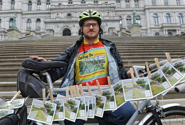 Biker James Meerdink from Parks & Trails New York along with others drop-off hundreds of postcards to the Capitol from riders who have recently completed the annual, cross-state Cycling the Erie Canal bike tour, urging the Governor to close the gaps that remain in the Erie Canalway Trail on Friday, Aug. 22, 2014 in Albany, N.Y. (Lori Van Buren / Times Union) Photo: Lori Van Buren / 00028288A