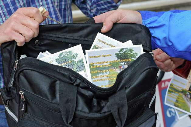 Bikers from Parks & Trails New York drop-off hundreds of postcards to the Capitol from riders who have recently completed the annual, cross-state Cycling the Erie Canal bike tour, urging the Governor to close the gaps that remain in the Erie Canalway Trail on Friday, Aug. 22, 2014 in Albany, N.Y. (Lori Van Buren / Times Union) Photo: Lori Van Buren / 00028288A