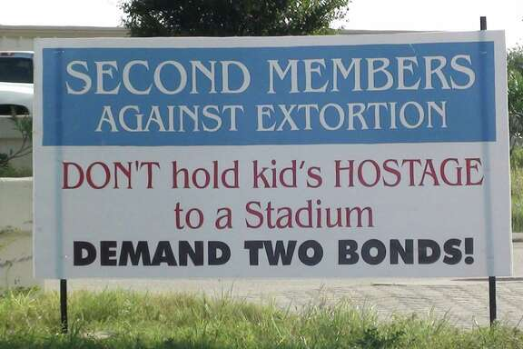 Signs displayed near Second Baptist Church West in Katy make reference to the upcoming bond proposal.
