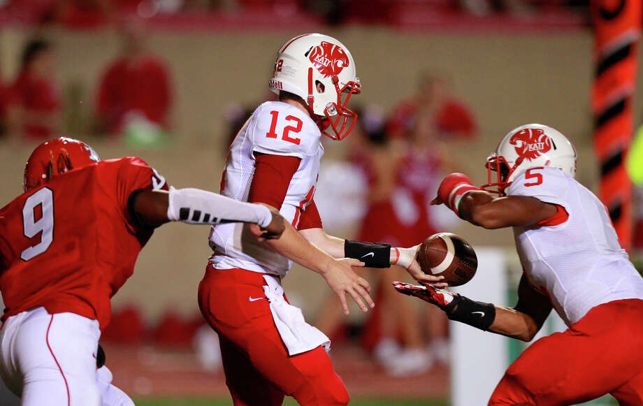 Katy quarterback Garrett Doiron, left, and running back Kyle Porter hope to pick up where they left off last season, which ended in the state title game. Photo: Cody Duty, Staff / © 2013 Houston Chronicle