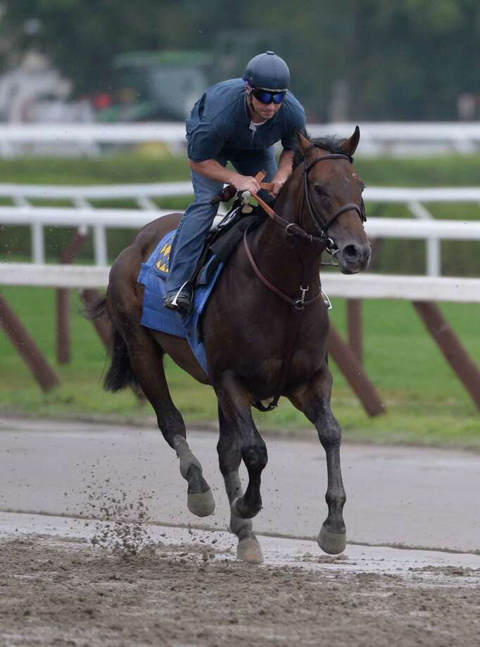 Travers Stakes morning line favorite, Bayern goes out for his daily exercise with rider Simon Harris Friday morning, Aug. 22, 2014, at Saratoga Race Course in Saratoga Springs, N.Y. (Skip Dickstein/Times Union) Photo: SKIP DICKSTEIN