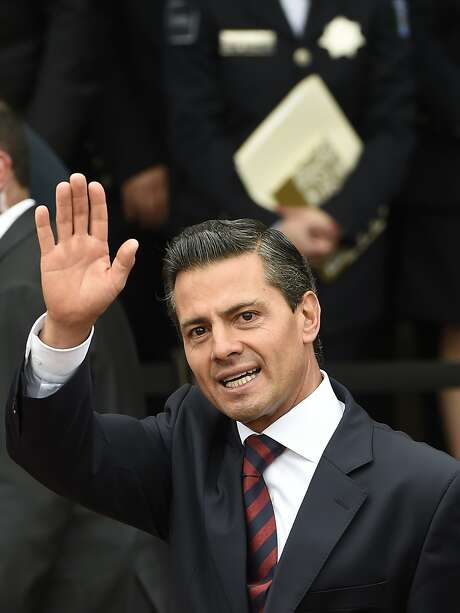 Mexican President Enrique Pena Nieto waves during the beginning of operations of the Mexican National Gendarmerie, a new group of the Federal Police, on August 22, 2014 in Mexico City. AFP PHOTO/RONALDO SCHEMIDTRONALDO SCHEMIDT/AFP/Getty Images Photo: RONALDO SCHEMIDT, Staff / AFP