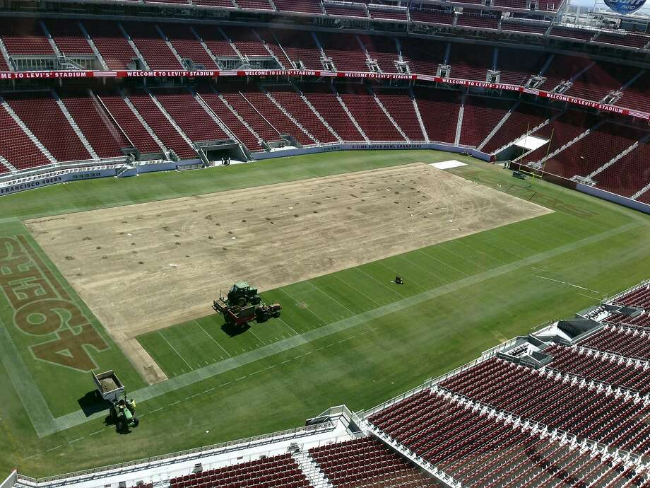 In this Aug. 21, 2014 photo released by Steve Hung, the field at Levi's Stadium is shown removed in Santa Clara, Calif. The San Francisco 49ers re-sodded the field at Levi's Stadium from goal line to goal line and sideline to sideline with longer grass Friday, Aug. 22, and they expect no problems for Sunday's preseason game against the San Diego Chargers. (AP Photo/Steve Hung) Photo: Steve Hung, Associated Press
