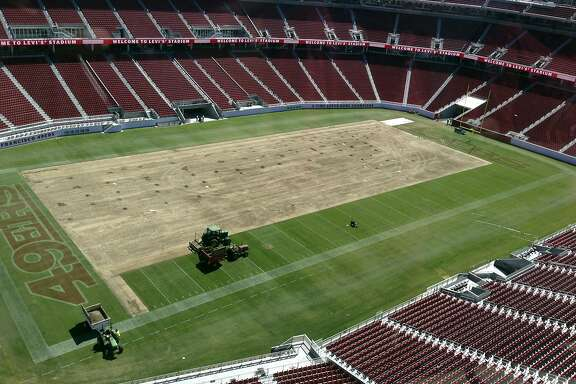 In this Aug. 21, 2014 photo released by Steve Hung, the field at Levi's Stadium is shown removed in Santa Clara, Calif. The San Francisco 49ers re-sodded the field at Levi's Stadium from goal line to goal line and sideline to sideline with longer grass Friday, Aug. 22, and they expect no problems for Sunday's preseason game against the San Diego Chargers. (AP Photo/Steve Hung)