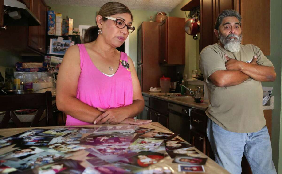 Mary Jimenez and her husband, Victor, take a break from looking through photos of their daughter Bianca. Her body has been found along the banks of the San Antonio River.