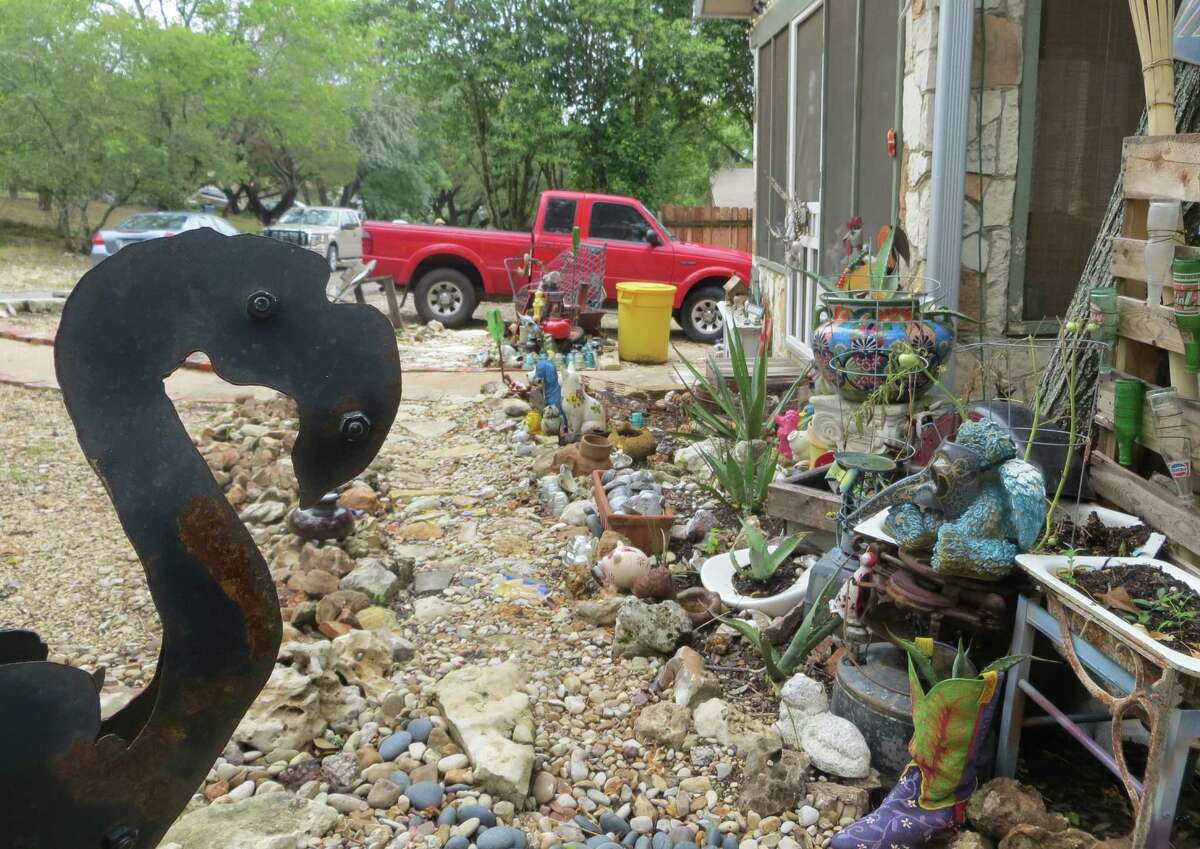 Renee Lofaso Massey says she assembled her yard-art display piece by piece and she's resisting demands by the city of Kerrville, which reportedly deems it