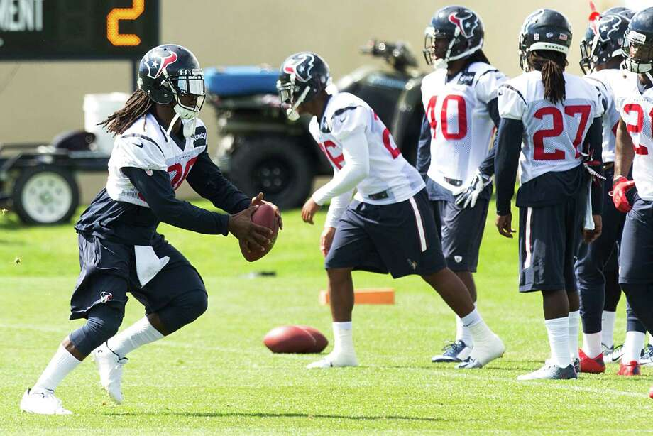Safety D.J. Swearinger, left, did anything but give the Broncos receivers the silent treatment in practices, and he'll likely crank up the volume for today's game. Photo: Brett Coomer, Staff / © 2014 Houston Chronicle