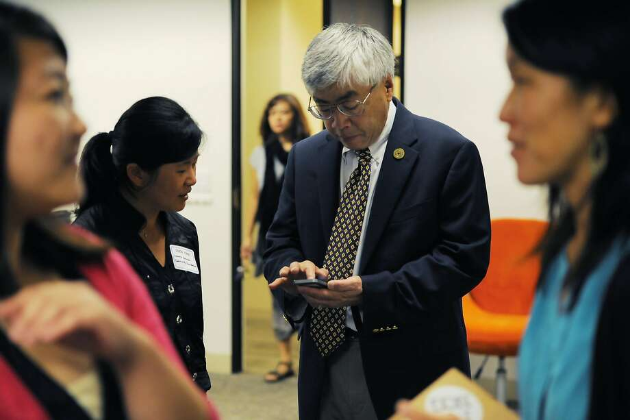 Buck Gee, a former Cisco vice president, chats with Dien Yuen at a recent event. He says that although many Asians work at leading tech companies, they hold few executive positions. Google is one place that offers greater opportunities. Photo: Craig Hudson, The Chronicle