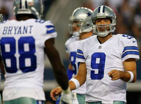Tony Romo, returning from back surgery, threw for 80 yards and a touchdown in his preseason debut last Saturday. Photo: Tom Pennington / Getty Images / 2014 Getty Images