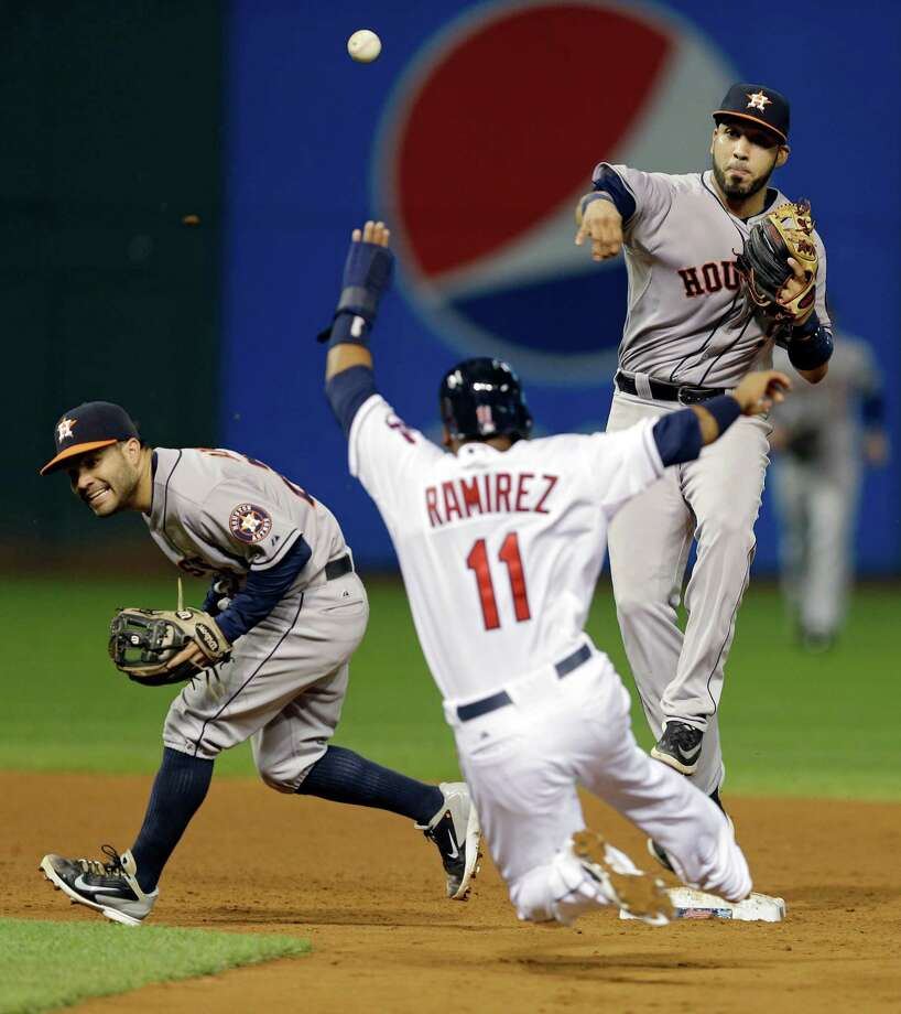 Jose Altuve, left, ducks out of the way so that Astros teammate Marwin Gonzalez can make the relay throw to first to complete a game-ending double play. Photo: Mark Duncan, STF / AP