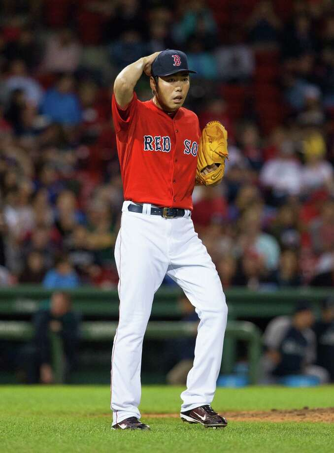 BOSTON, MA - AUGUST 22: Koji Uehara #19 of the Boston Red Sox reacts after giving up 5 runs during the ninth inning against the Seattle Mariners at Fenway Park after leading 3-0 on August 22, 2014 in Boston, Massachusetts. (Photo by Rich Gagnon/Getty Images) ORG XMIT: 477588459 Photo: Rich Gagnon / 2014 Getty Images