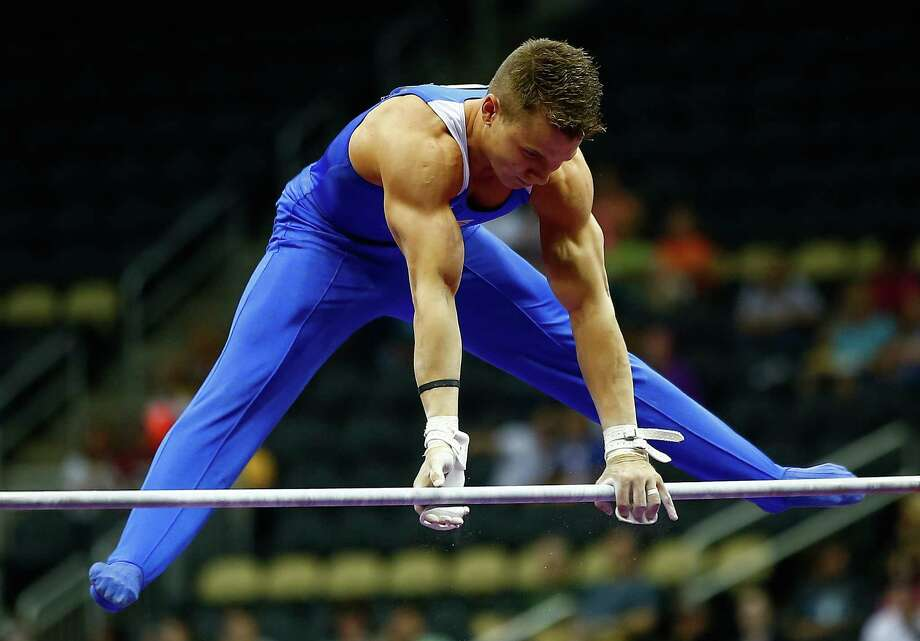 Jonathan Horton of Houston works on the high bar Friday night - his first competition since the 2012 Olympics after undergoing surgery on both shoulders. Photo: Jared Wickerham, Stringer / 2014 Getty Images