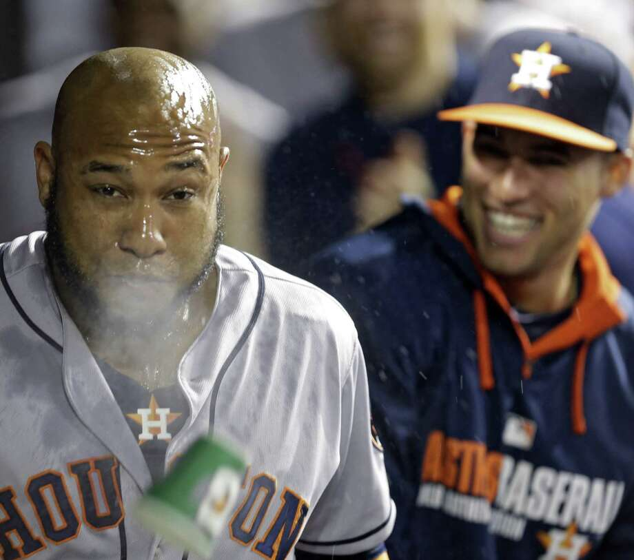 Jon Singleton spits water after his three-run homer in the ninth inning helped the Astros to victory in Cleveland. The game was tied 1-1 before the frame. Photo: Mark Duncan / Associated Press / AP