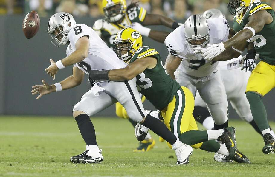 Matt Schaub, who continued to struggle in his third preseason game, fumbles on a first-half hit by linebacker Nick Perry. Photo: Tom Lynn, Associated Press