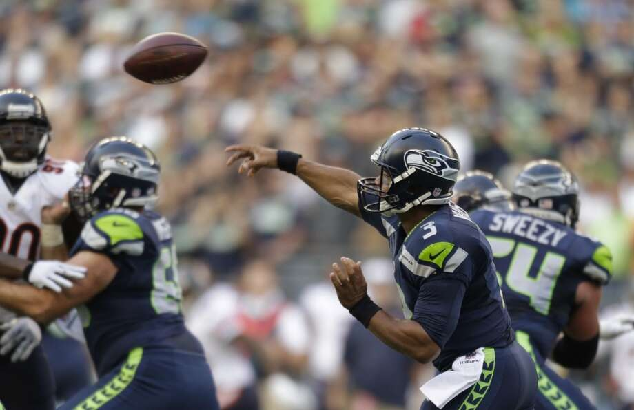 """1. The O-line looks ... pretty darn goodWe're cautiously optimistic, but Seattle's offensive line is shaping up to be, well, good. Really good. Great? Not   sure we'll go that far. Not yet.Against the Bears' starting defense, the Seahawks were able to open running lanes with ease and give Russell Wilson   plenty of time to find his targets. They were dominant on Seattle's first drive as Marshawn Lynch marched downfield   and, once seven yards out, strolled into the end zone. They were mostly impressive on Seattle's second drive, when   Wilson led his offense 89 yards to the end zone in 14 plays. They looked great when — well, you get the idea.   Left tackle Russell Okung was the O-line's weakest point Friday, but is still clearing out the cobwebs after offseason   foot surgery.If this third preseason game was merely a """"dress rehearsal,"""" we shudder to think what the Seahawks offense will look   like once they start playing for real. Last season, the O-line was Seattle's biggest missing piece; it's looking like   Pete Carroll and Co. have solved that puzzle. We don't want to speak too soon -- this is the preseason, after all --   but the Seahawks might have not just a top defense, but also one of the league's top offenses in 2014. Photo: John Froschauer, Associated Press"""