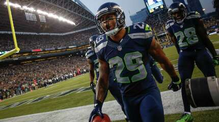 SEATTLE, WA - AUGUST 22:  Punt returner Earl Thomas #29 of the Seattle Seahawks celebrates after returning a punt for a long gain against the Chicago Bears at CenturyLink Field on August 22, 2014 in Seattle, Washington.