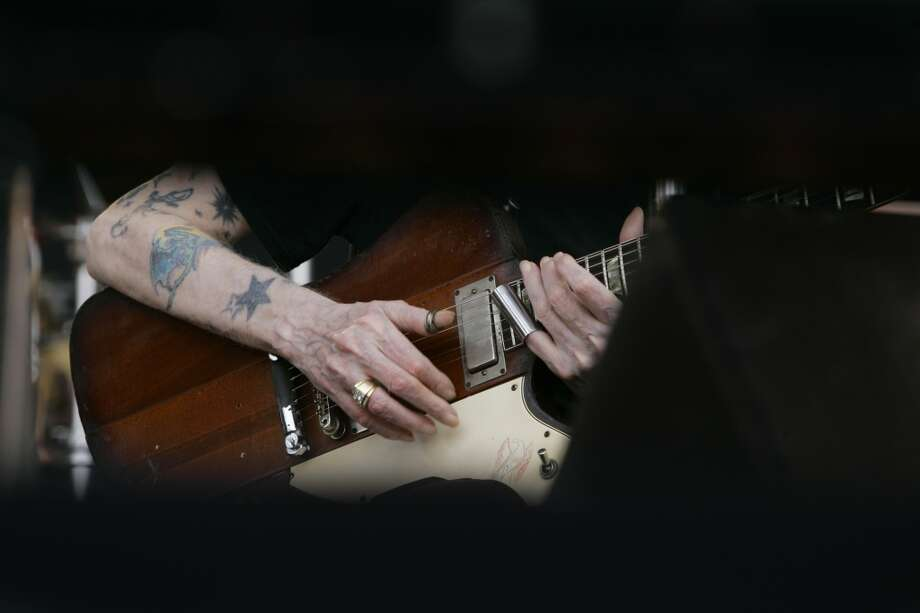 "The hands of Johnny Winter perform  ""Highway 61"" at the Crossroads Guitar Festival in Chicago, Saturday, July 28, 2007. (AP Photo/Charles Rex Arbogast) Photo: ASSOCIATED PRESS"