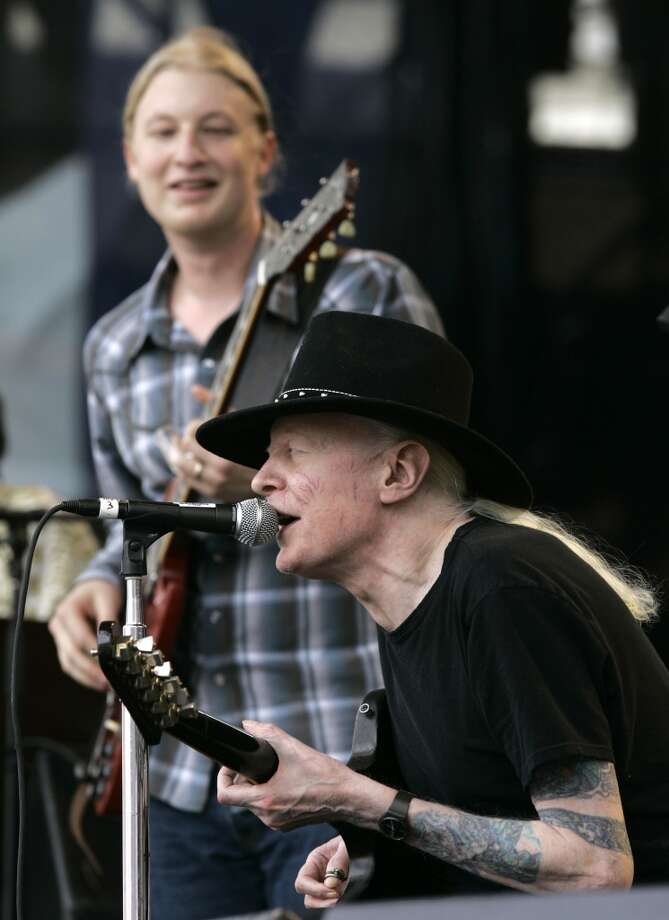 "In this Saturday, July 28, 2007 file photo, Johnny Winter, seated, and Derek Trucks, background, perform ""Highway 61"" at the Crossroads Guitar Festival in Chicago. Texas blues icon Johnny Winter, who rose to fame in the late 1960s and '70s with his energetic performances and recordings that included producing his childhood hero Muddy Waters, died in Zurich, Switzerland on Wednesday, July 16, 2014. He was 70. (AP Photo/Charles Rex Arbogast, File) Photo: Associated Press"