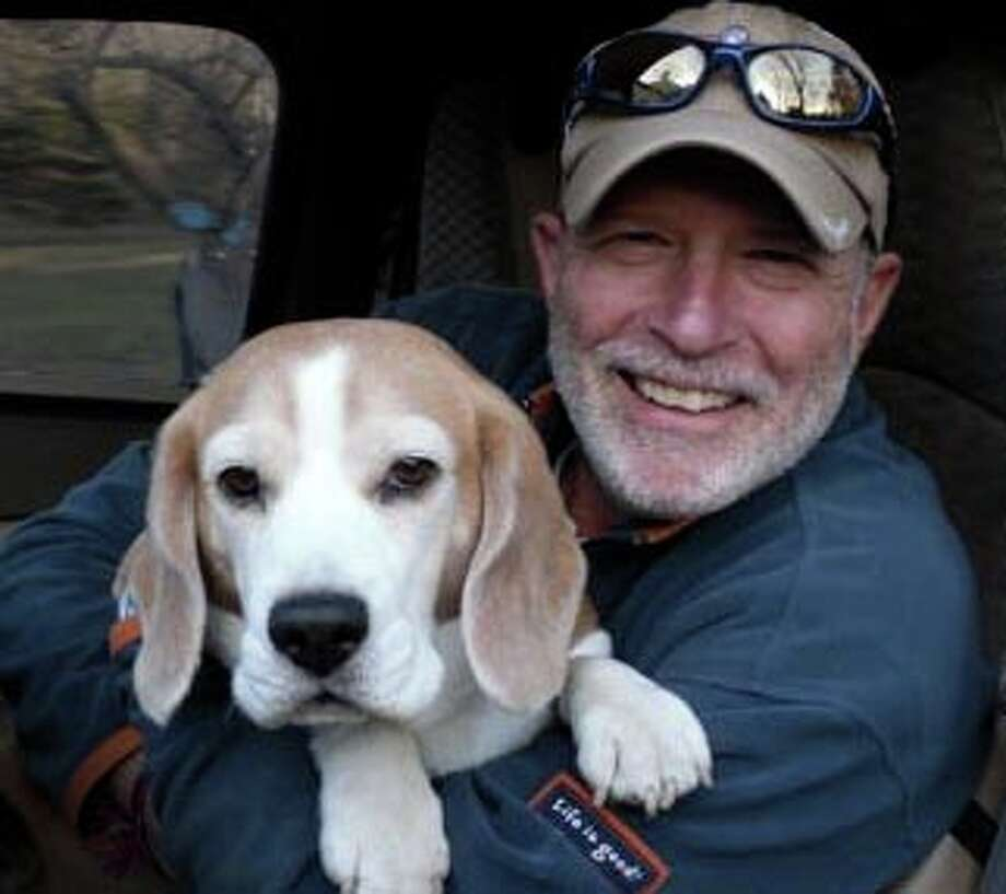 "Columnist Hank Herman with Ricky the Beagle: ""Itís been just over three months since our beloved Ricky the Beagle passed away. On April 18, in my column 'Goodbye to a good, good dog,' I wrote about how Ricky was an important part of every day of my life for 11 years. In the weeks since he died, Iíve missed his cuddly little presence big time. On the other hand ... I do have to admit that going dog-less gives you a certain degree of freedom. And adds some pretty big chunks of discretionary time to your day."" Photo: Contributed Photo / Westport News"