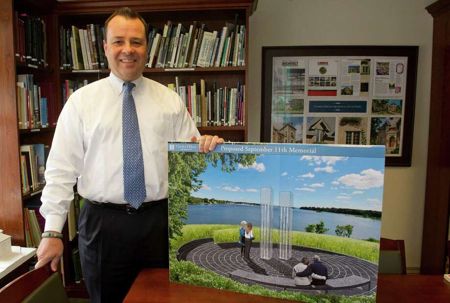 Charles Hilton poses for a photo in his Greenwich office with a rendering of his design for the Cos Cob Park September 11 memorial on Friday, August 15, 2014. Photo: Lindsay Perry / Stamford Advocate