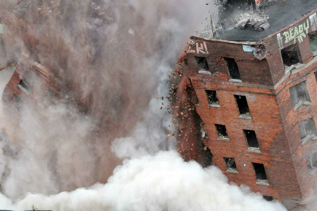 The 11-story Wellington Annex on Howard Street is imploded Saturday morning, Aug. 23, 2014, in Albany, N.Y. The building was demolished to make way for Albanya€™s new $66.5 convention center. (Will Waldron/Times Union)