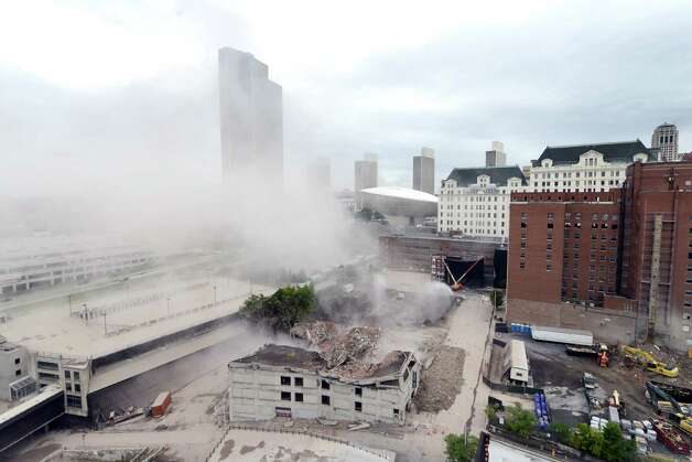 Dust begins to settle after the  11-story Wellington Annex on Howard Street is imploded Saturday morning, Aug. 23, 2014, in Albany, N.Y. The building was demolished to make way for Albanya€™s new $66.5 convention center. (Will Waldron/Times Union) Photo: WW / 00028210B