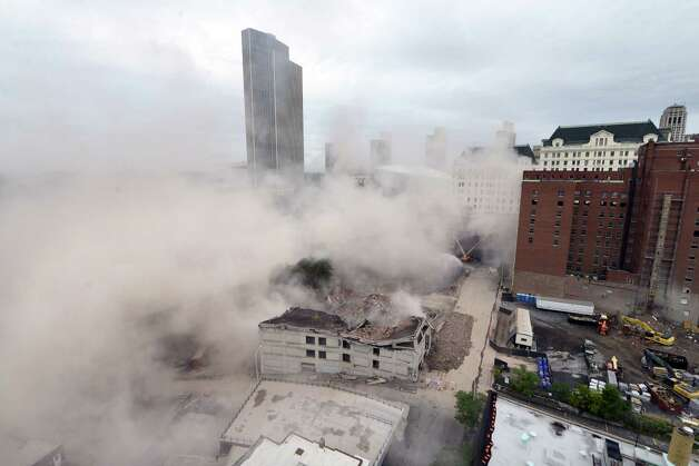 Dust settles after the  11-story Wellington Annex on Howard Street is imploded Saturday morning, Aug. 23, 2014, in Albany, N.Y. The building was demolished to make way for Albanya€™s new $66.5 convention center. (Will Waldron/Times Union) Photo: WW / 00028210B
