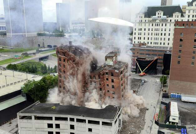 The 11-story Wellington Annex on Howard Street is imploded Saturday morning, Aug. 23, 2014, in Albany, N.Y. The building was demolished to make way for Albanya€™s new $66.5 convention center. (Will Waldron/Times Union) Photo: WW / 00028210B