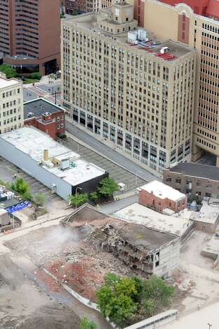 The dust settles following the implosion of Wellington Annex on Saturday, Aug. 23, 2014, in Albany, N.Y. (Cindy Schultz / Times Union) Photo: Cindy Schultz / 00028210C